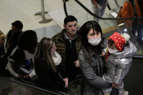 Passengers with masks at Seattle Tacoma International Airport