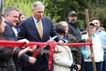 Bothell Mayor Andy Rheaume and Gov. Jay Inslee cut the ribbon to celebrate the city's procurement of all of North Creek Forest