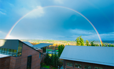 Image of a rainbow over the wetlands below UW Bothell
