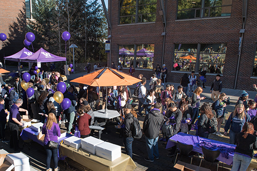 photo from W day of many students and booths