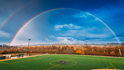 UW Bothell sports field with double rainbow over it