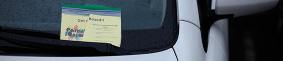 image of flyer on car