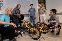 Tyler Folsom and research team of students work on autonomous trike upgrades