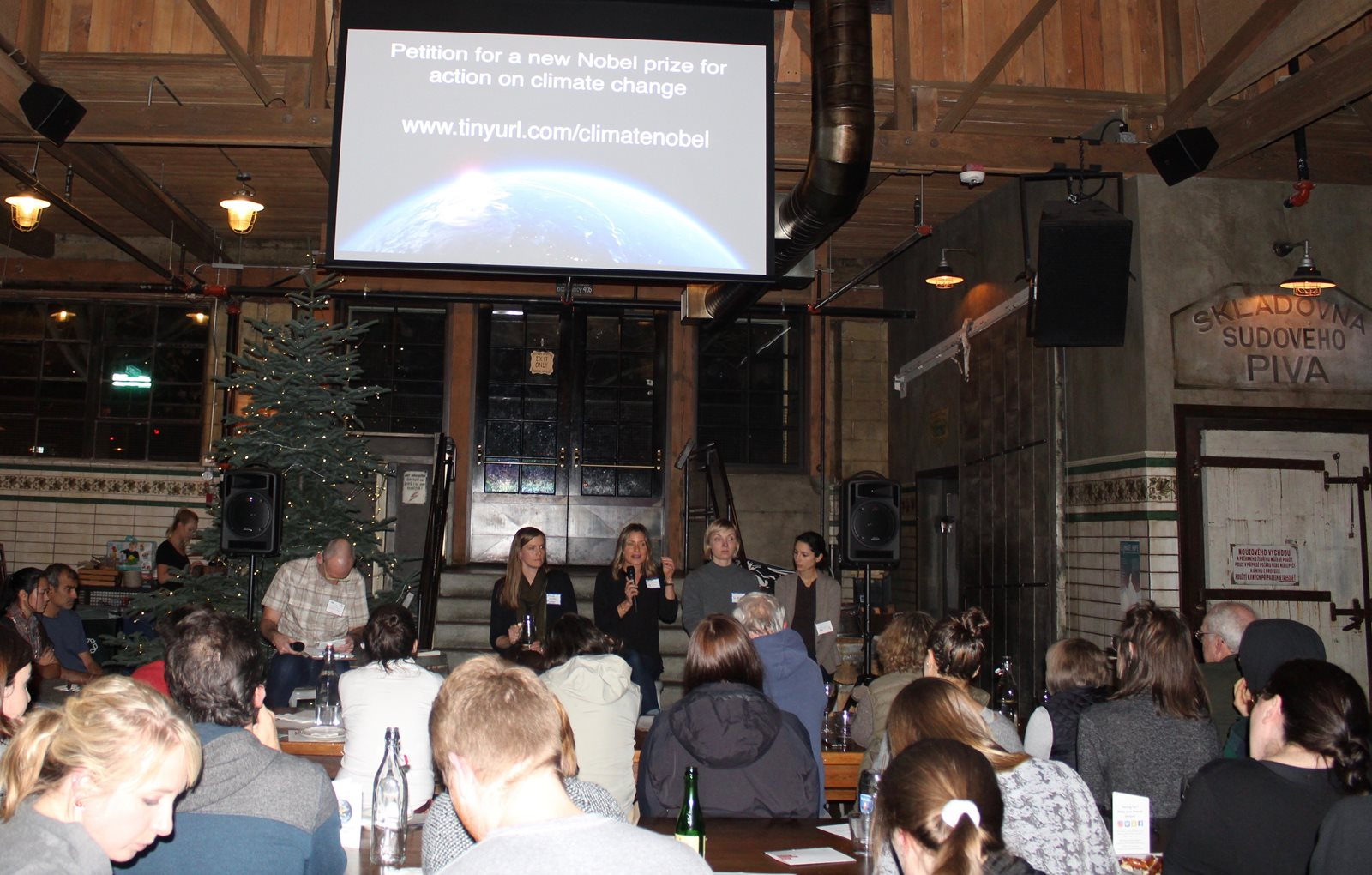 Climate Science on Tap event showing panel