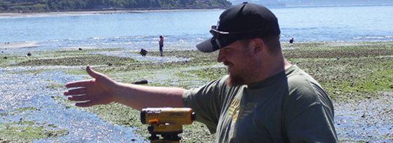 Chris Scott in BIS 293 taking measurements at the beach