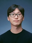 "Sunwoong ""Sunny"" Kim, wearing a black shirt with black glasses. Photo by Marc Studer"