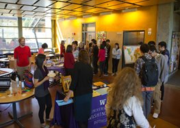 Students gathering around tables showcasing study abroad