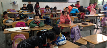 Kids in an English class in China. Photo courtesy of Kyle Merry.
