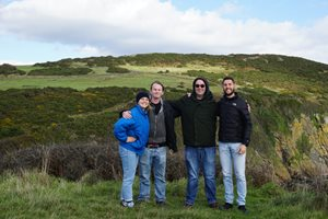 Philip Palios with grad student peers, in the countryside in Scotland