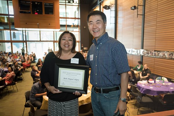 Staff appreciation award winner Beth Miguel Alipio with Chancellor Yeigh