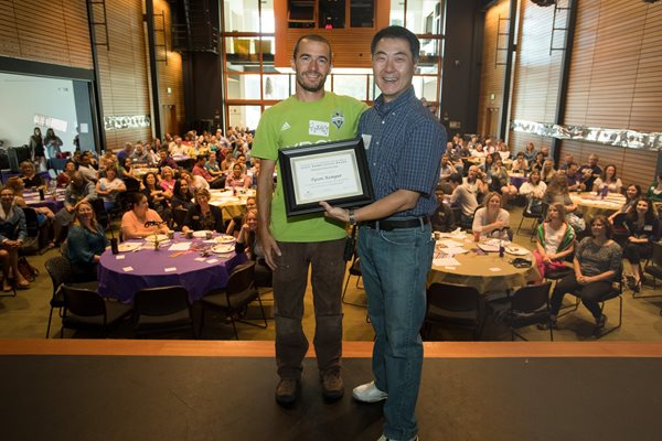 Staff Appreciation award winner Tyson Monas smiling with Chancellor Yeigh