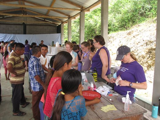 Students distribute supplies to villagers during a study abroad trip to Guatemala in Summer 2018 led by faculty member Mabel Ezeonwu