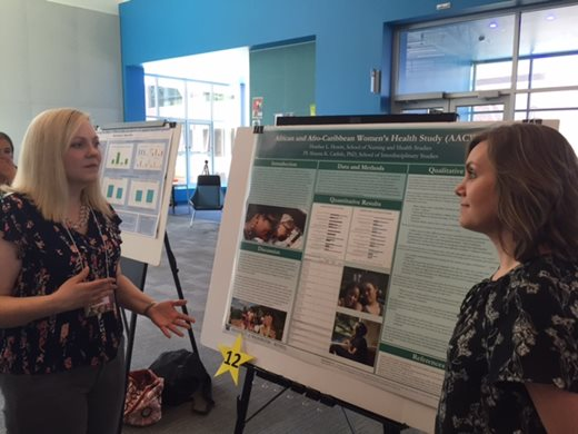 A Health Studies student presents a research poster on African and Afro-Caribbean Women's Health