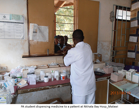 PA student dispensing medicine to a patient at Nkhata Bay Hosp_Malawi