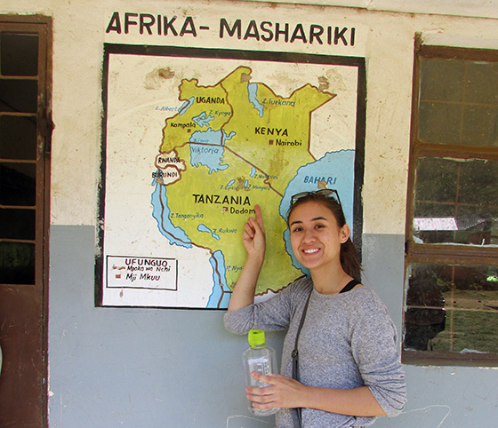 Exploration Seminar student pointing to Tanzania on map of Africa