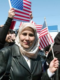 woman wearing hijab holding American flag