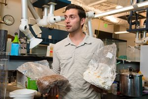 Kellen Maloney with bag of mycelium