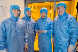 Four scientists in clean room air lock
