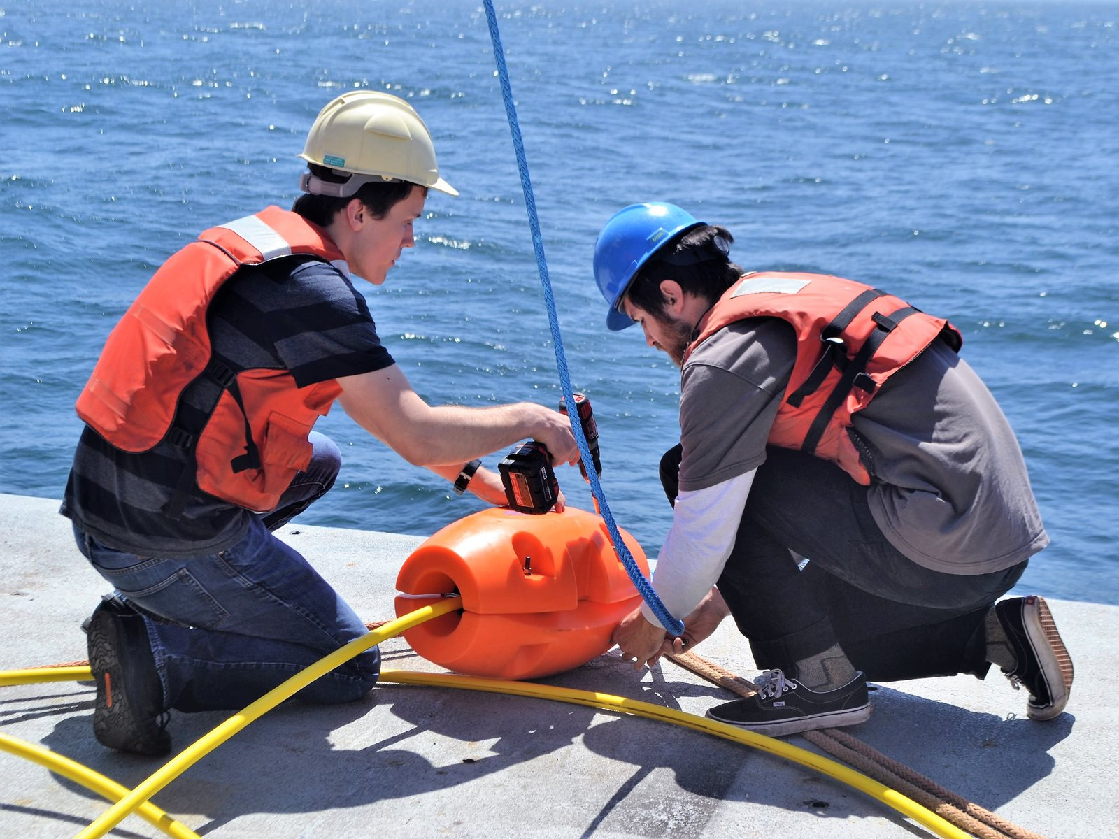students working on a buoy