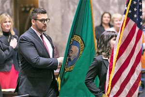 Avi Socha carries state flag