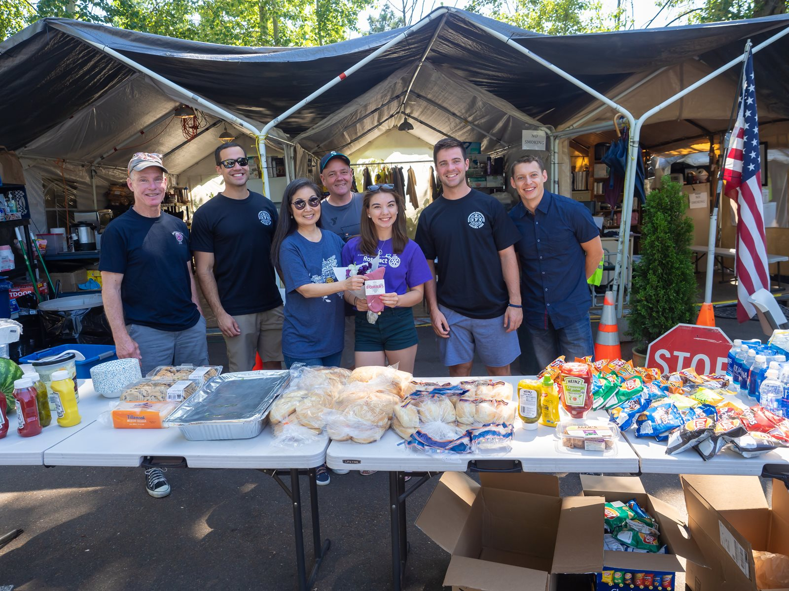 Volunteers and food table at barbecue