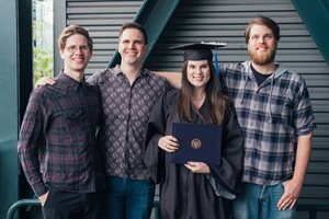 Molly's graduation with her brothers
