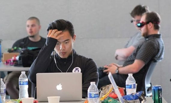Student stares intently at laptop