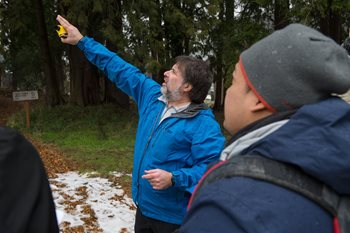 Warren Gold pointing at tree canopy