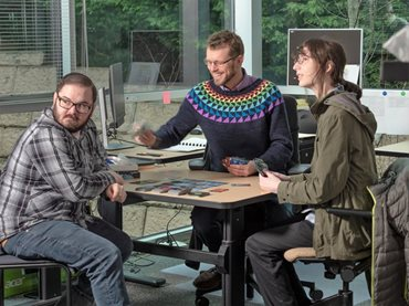 Zaneveld and two of his research students.