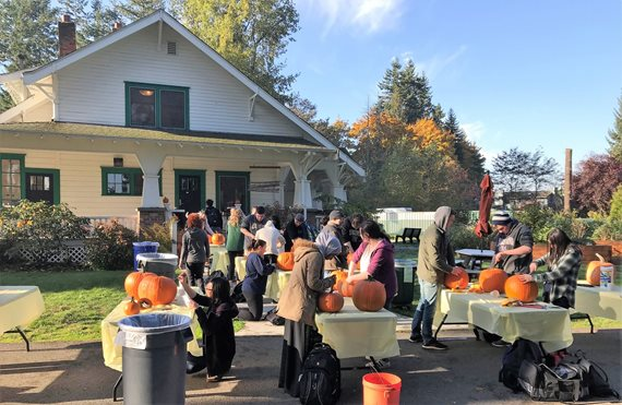 Students carve pumpkins at Truly House.