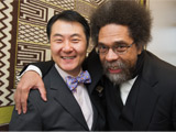 Chancellor Yeigh and Cornel West, with their arms over each other's shoulders
