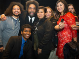 Cornel West posing with a small group of students