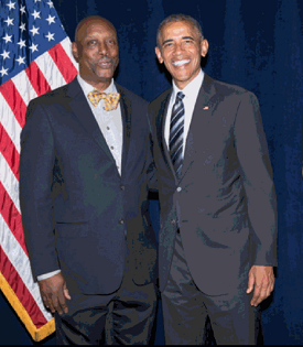 Warren Buck with President Obama