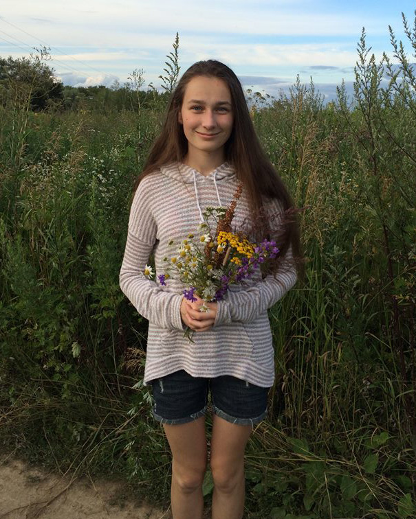 Polina with flowers.jpg
