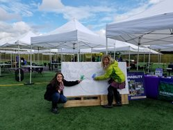 UW Bothell Sustainability Office making a pledge to their pledge board at the 2017 Sustainability Festival