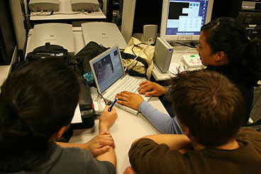 Students working together in media lab
