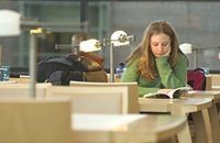 student studying in reading room